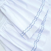 Crib Skirt with Embroidered Sailboat